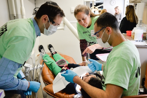 Faculty and Students Provide Dental Care to Children at Give Kids a Smile Event