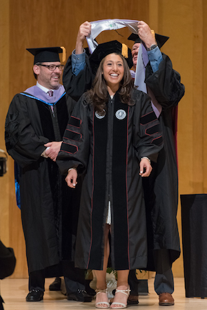 Alexis Gertler, DDS, is hooded, signifying her academic achievement and doctoral degree at Stony Brook School of Dental Medicine's 2018 Convocation.