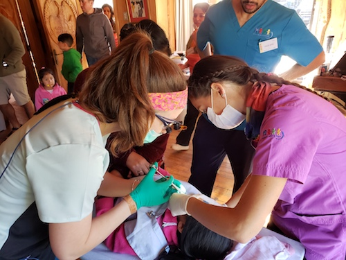 Stony Brook School of Dental Medicine students provide dental treatment in Neltume, Chile.