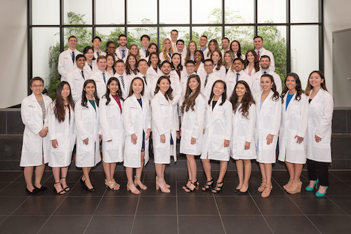 Group portrait of Stony Brook School of Dental Medicine's Class of 2022 at the 2019 White Coat Ceremony.