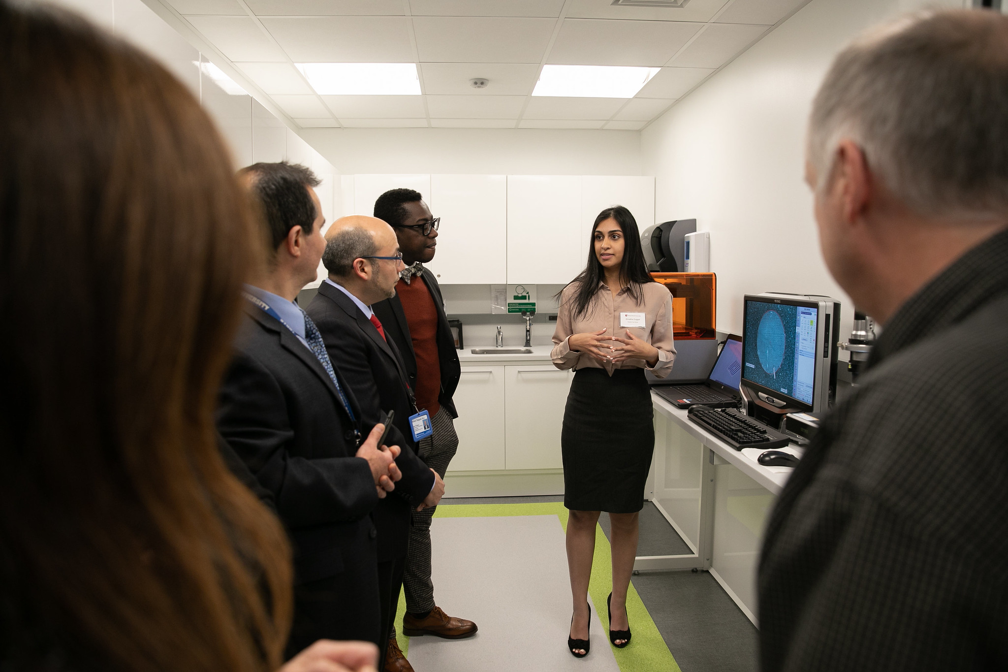 Stony Brook University School of Dental Medicine student Shradha Duggal explains her research in the Center for Implant and Digital Technology