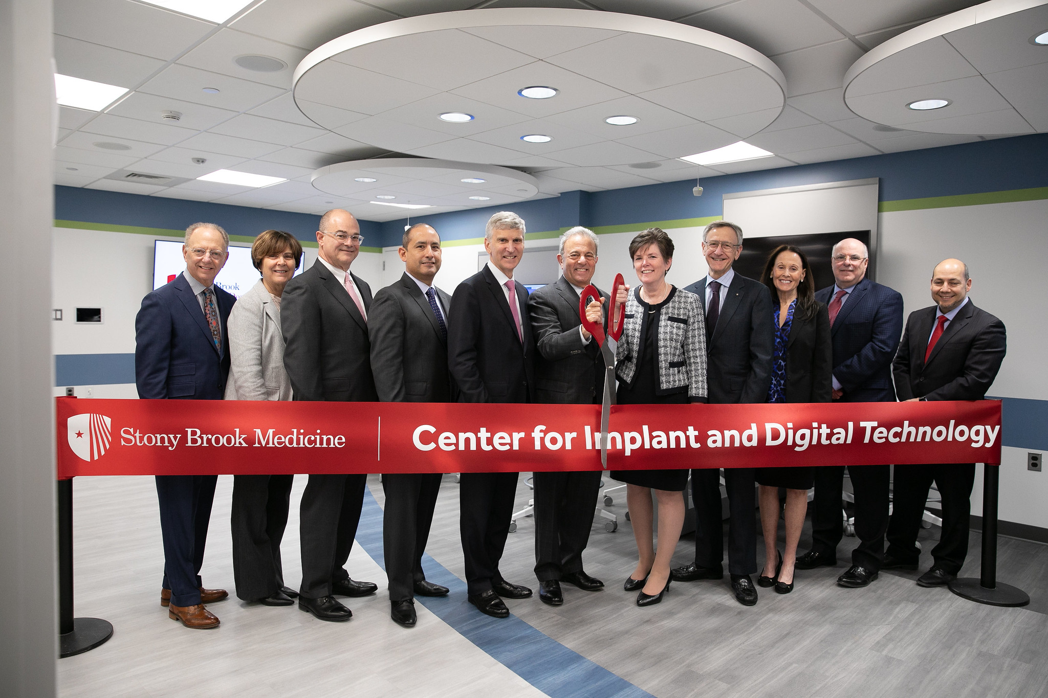 Pictured from left: Dr. Robert Reiner, Clinical Associate Professor; Carol Sloane, Assistant Dean for Clinical Operations; Dr. Allan Kucine, Associate Dean for Information Technology; Axel Calderon, Manager of the Center for Implant and Digital Technology; Cary Staller, Stony Brook Foundation and SUNY Trustee; Dr. Michael Bernstein, Stony Brook University Interim President; Dr. Kenneth Kaushansky, Senior Vice President of the Health Sciences and Dean of the Renaissance School of Medicine; Dr. Mary R. Truhlar, Dean; Dr. Ann Nasti, Associate Dean for Clinical Education; Dr. Steven Zove, Associate Dean for Clinical Affairs; Dr. Rafael Delgado-Ruiz, Associate Professor