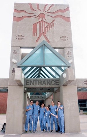Stony Brook School of Dental Medicine Students Outside Pine Ridge Indian Health Services Hospital Facility