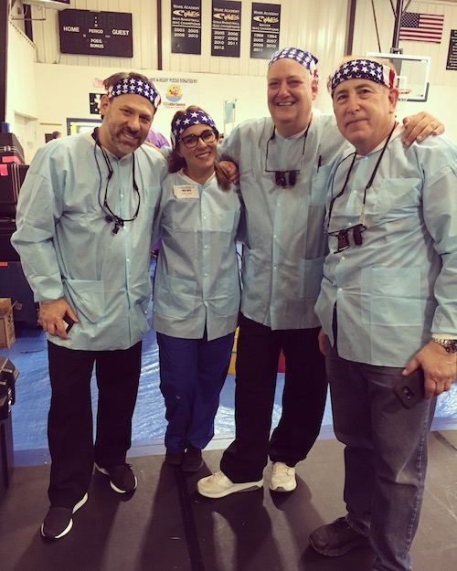 Dr. Gabriele Conte, Dr. Clarisa Amarillas, Dr. Jeffrey Seiver, and Dr. Scott Firestone of Stony Brook School of Dental Medicine at a Pop-up Clinic in Gloucester, VA
