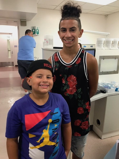 Two Patients of Stony Brook School of Dental Medicine's Give Kids A Smile Event Show Off Their Smiles