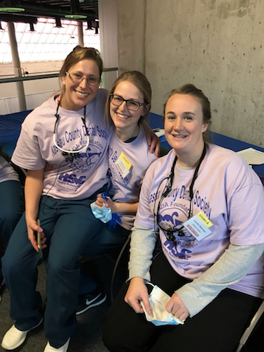 Stony Brook School of Dental Medicine students at Give Kids A Smile event in Garden City, New York