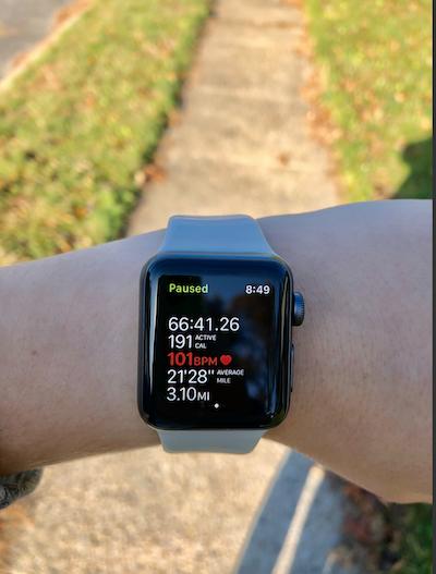 Exercise statistics on Apple watch on wrist.