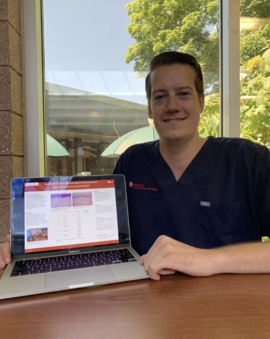 Student Phil Bacigalupo presents his research abstract virtually on his laptop as part of Stony Brook University School of Dental Medicine's annual research day.