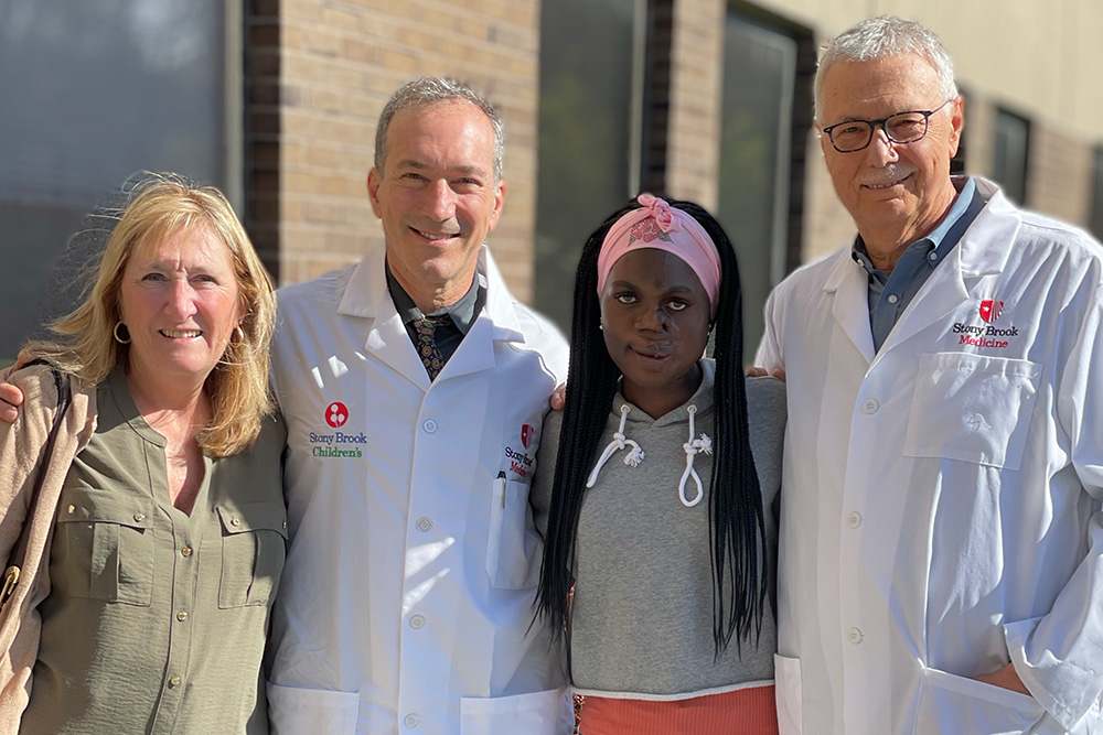A group photo featuring Saline Atieno (second from right) with (from left) host Kerri Tame, Alexander Dagum, MD, and Leon Klempner, DDS.