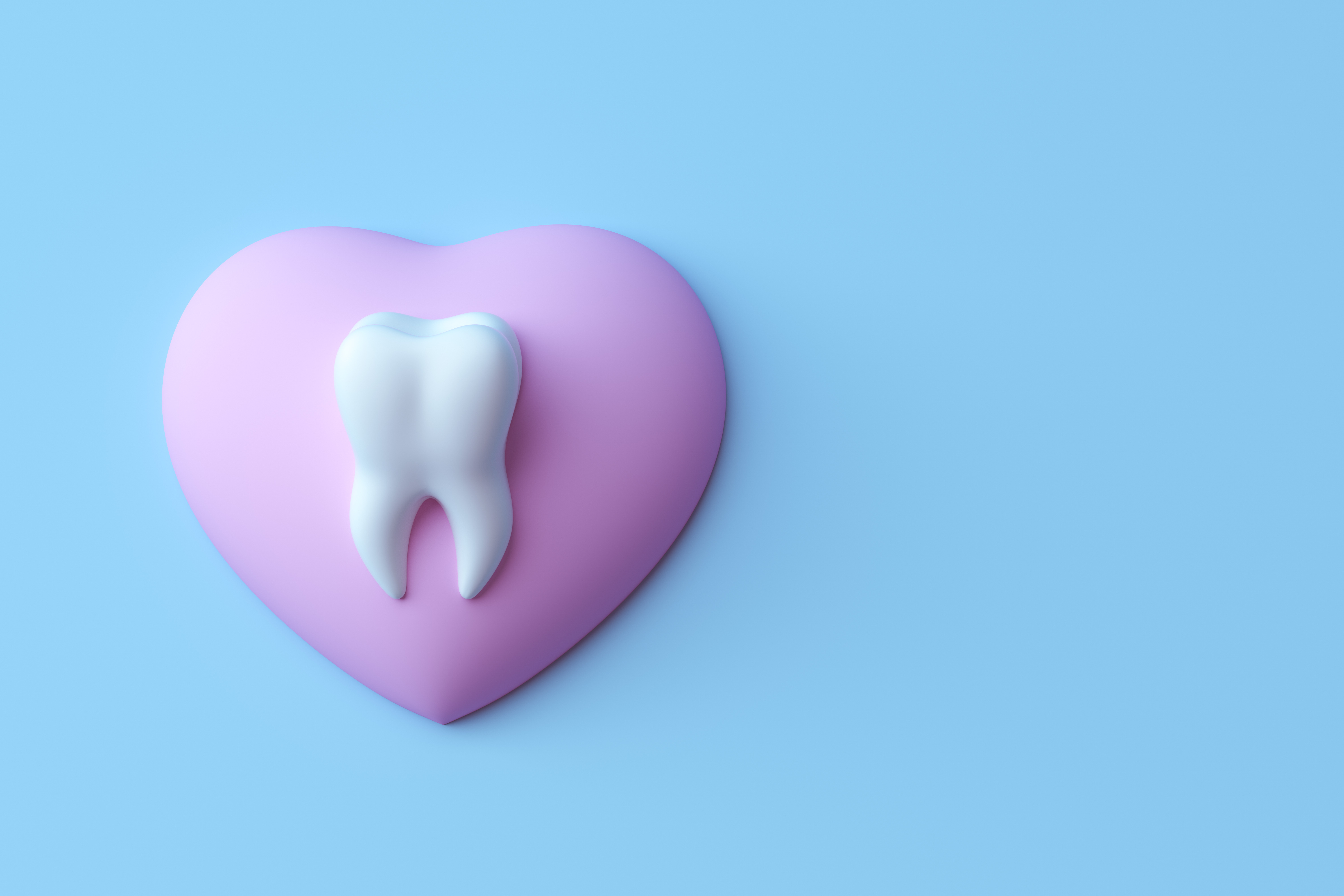 An image of a tooth on top of a pink heart with a blue background.