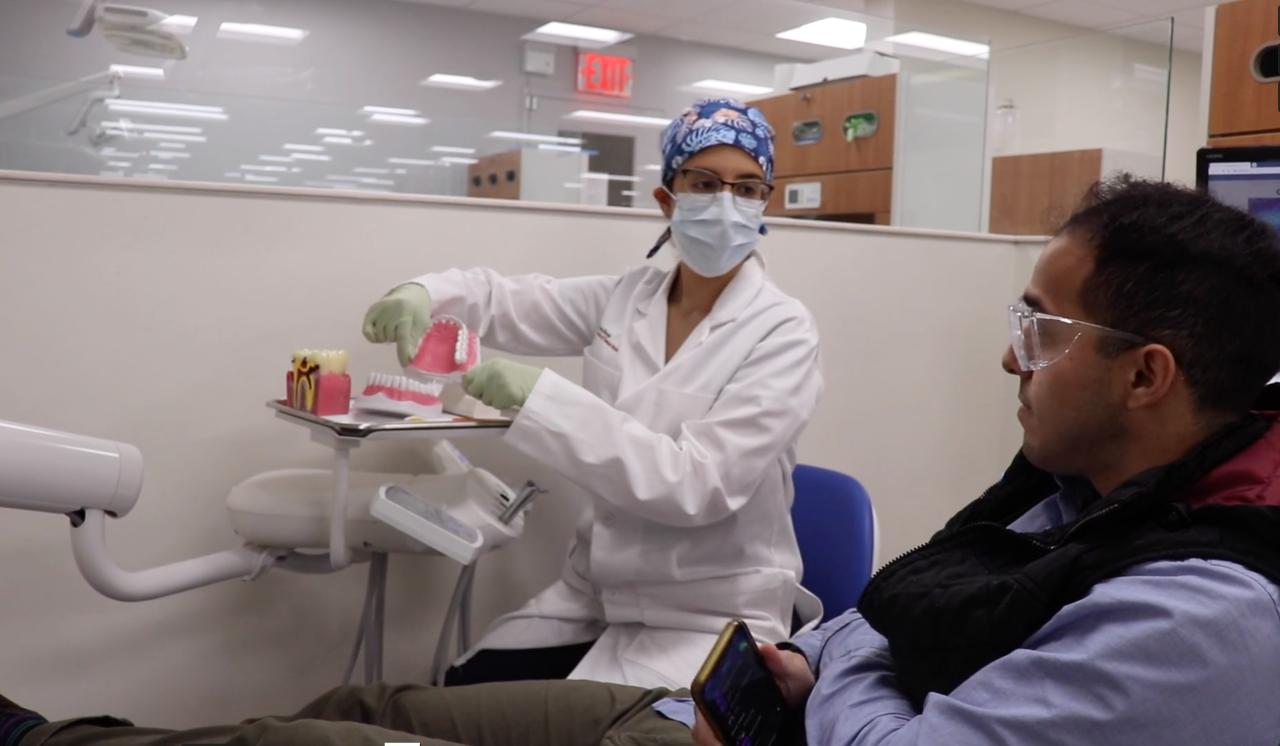 Viviana Torres Rizo provides oral health instruction to a patient.