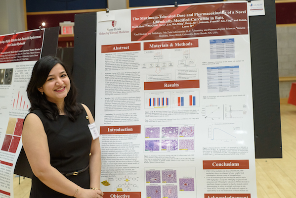 Dr. Heta Dinesh Bhatt with her research poster at Stony Brook University School of Dental Medicine's 2019 Leo and Mickey Sreebny Lectureship and School of Dental Medicine Research Symposium