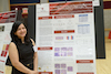 Heta Dinesh Bhatt, BDS, PhD stands beside her research poster at Stony Brook School of Dental Medicine's annual day of research.